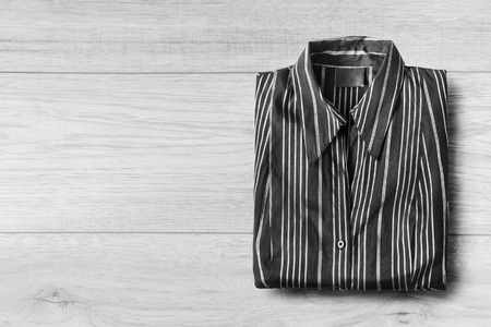 formal dressing: Striped shirt on white wooden background