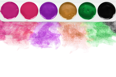 Colorful watercolor paints on white background