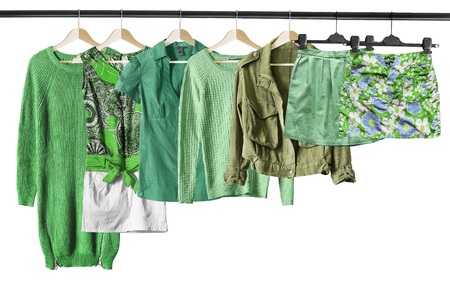 green clothes: Set of green clothes on clothes racks isolated over white Stock Photo