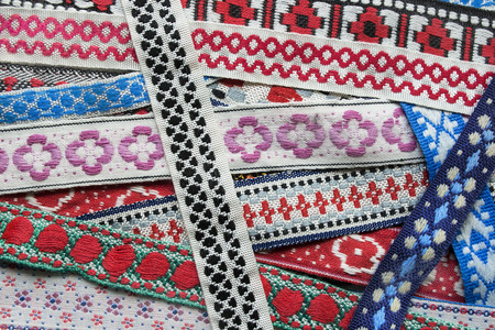 embroidered: Ethnic embroidered laces closeup as a background