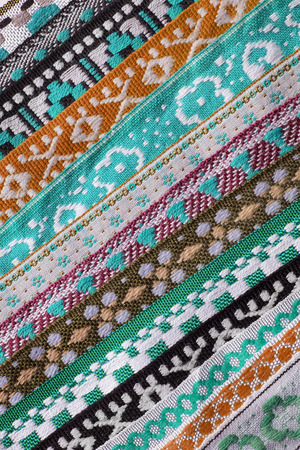 embroidered: Colorful ethnic embroidered laces as a background