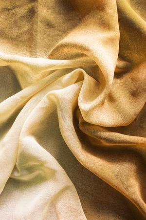 draped: Draped yellow chiffon closeup as a background