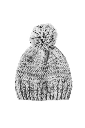 pompom: Knitted gray pompom hat isolated over white