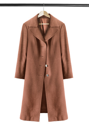 Elegant brown coat on wooden clothes rack isolated over white
