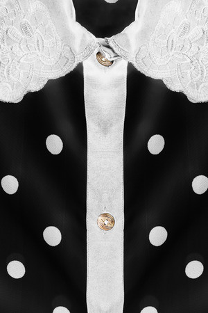 neckband: White collar on black silk blouse as a background Stock Photo
