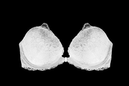 strapless: White lacy strapless push up bra on black background Stock Photo