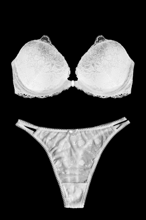 strapless: White lacy lingerie on black background