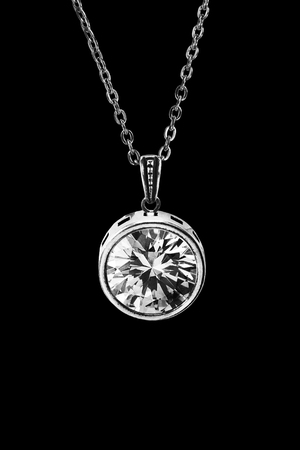 Crystal pendant on silver chain isolated over black Stock Photo