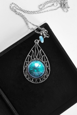 Silver turquoise pendant on a chain in black jewel box