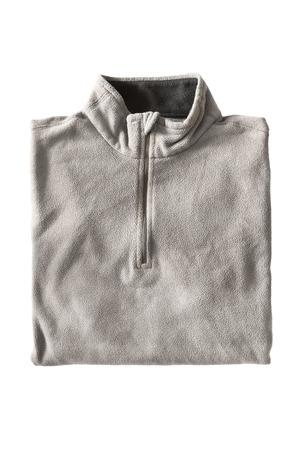 warm shirt: Beige fleece sport pullover folded on white background Stock Photo