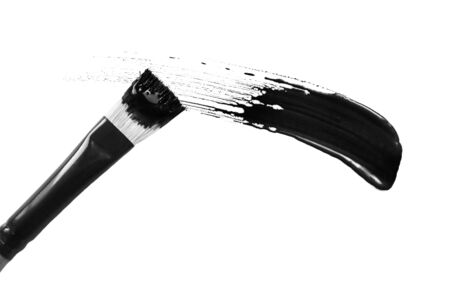 Painting brush drawing black color on white background