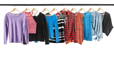 d11cac37276f8b  83651984 - Set of shirts and blouses hanging on clothes racks isolated  over white