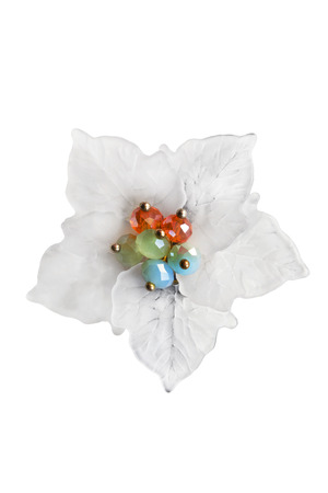 gloss: White flower brooch with colorful beads isolated over white