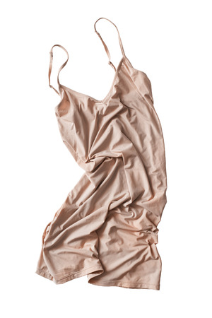 Crumpled beige silk dress isolated over white