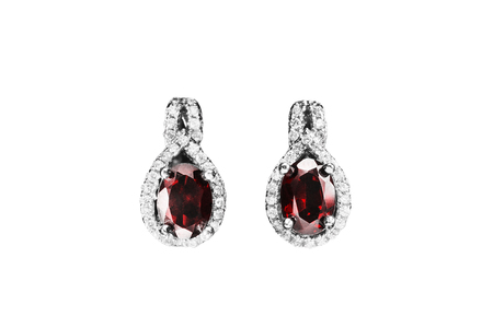 Ruby earrings with diamonds isolated over white