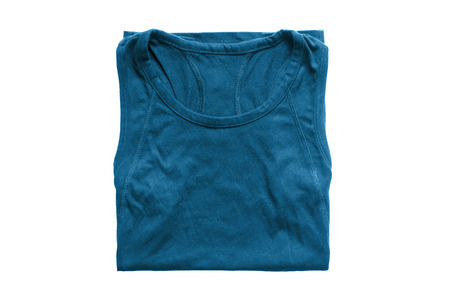 Folded blue cotton sport top isolated over white