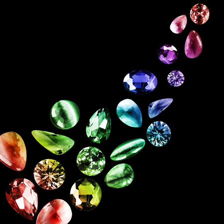 Abstract group of colorful gemstones on black background