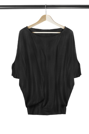 Black oversized pullover on wooden clothes rack isolated over white Stock Photo