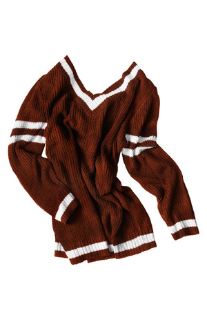 Crumpled brown sport sweater isolated over white Foto de archivo