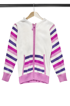 Knitted pink and white sport jacket on wooden clothes rack isolated over white Foto de archivo