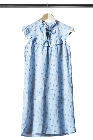 Blue cotton sleeveless dress on wooden clothes rack isolated over white