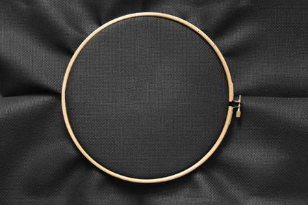 Black blank canvas on wooden round frame as a background 写真素材