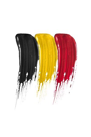 Paint brush strokes in colors of belgium national flag isolated over white 写真素材