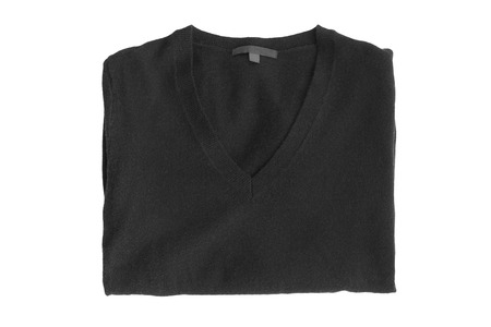 Black folded cashmere sweater isolated over white