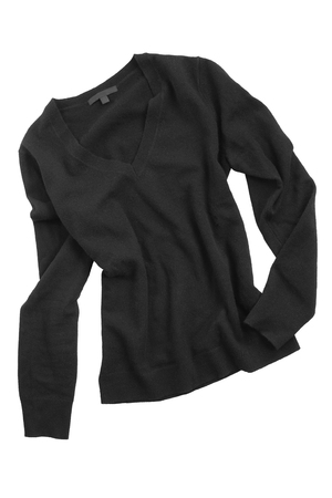 Crumpled black basic cashmere sweater on white background