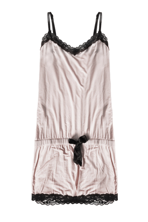 Silk beige nightdress with black lace and straps on white background Banco de Imagens