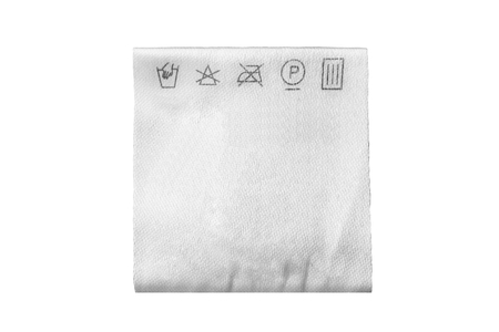 Textile care clothes label isolated over white Stockfoto