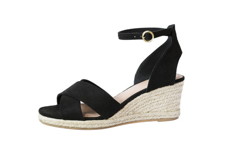 One black velvet wedge heeled shoe isolated over white