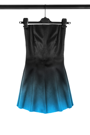 Black satin mini strapless dress with blue skirt hanging on clothes rack isolated over white