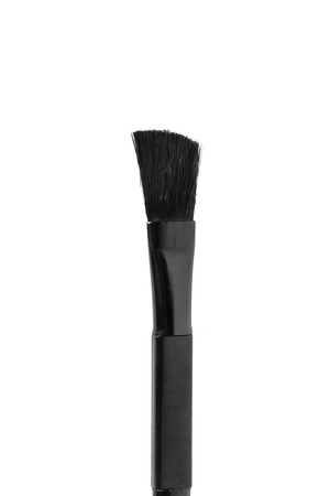 Black makeup brush closeup on white background Imagens