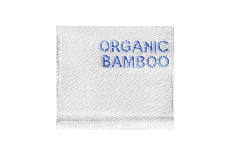 Textile clothes label says organic bamboo isolated over white