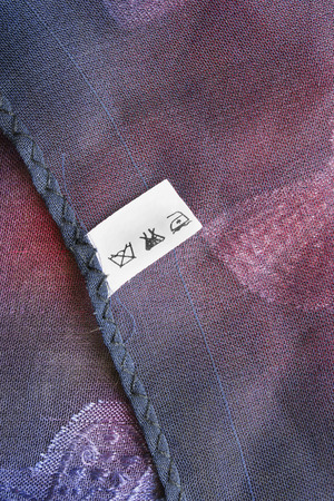 Care clothes label on colorful silk background