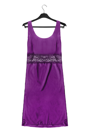 Purple satin lacy dress on black clothes rack isolated over white Banco de Imagens