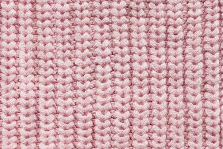 Gros plan de la texture tricotée en laine rose comme arrière-plan Banque d'images