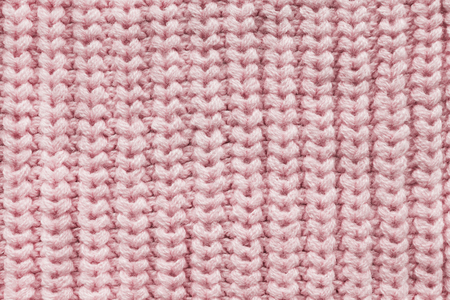 Pink wool knitted texture closeup as a background