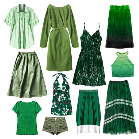 Green woman clothes on white background Imagens