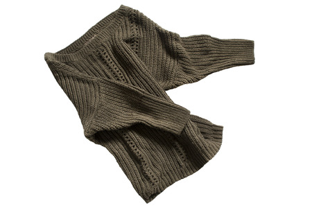 Crumpled brown knitted sweater on white background