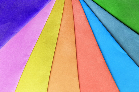 Colorful sheets of wrapping paper closeup as a background