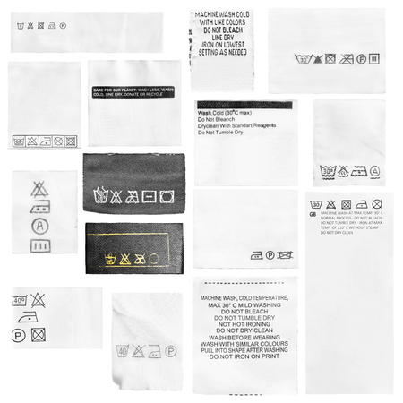 Group of care clothes labels on white background Stockfoto