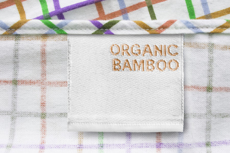 Clothes label says Organic Bamboo on colorful textile background