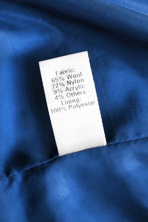 Fabric composition clothes label on blue textile background