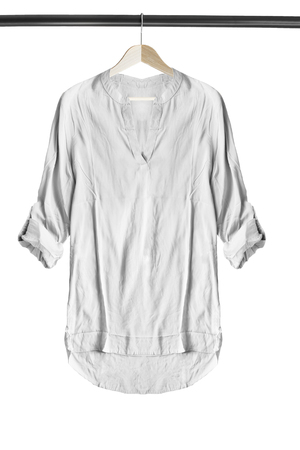 White silk blouse on wooden clothes rack isolated over white Stockfoto