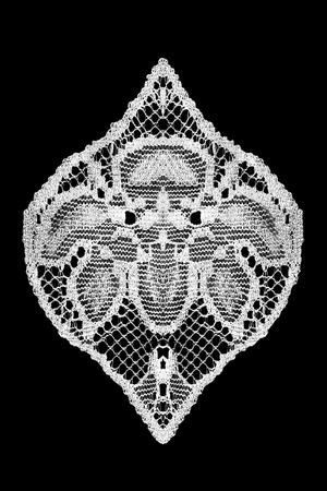 White vintage lace detail on black background Фото со стока