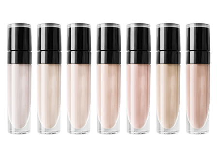 Palette of liquid foundation tones isolated over white