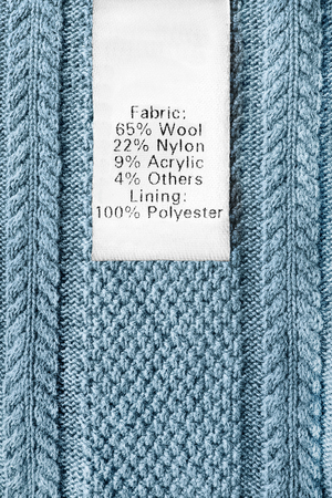 Fabric composition clothes label on blue knitted background Archivio Fotografico