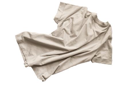 Basic beige crumpled t-shirt on white background